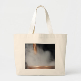copper pipe of a distillery with steam. large tote bag