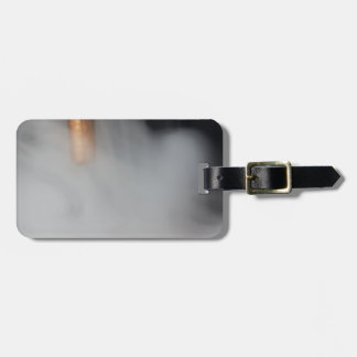 copper pipe of a distillery with steam. luggage tag