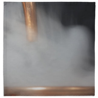 copper pipe of a distillery with steam. napkin