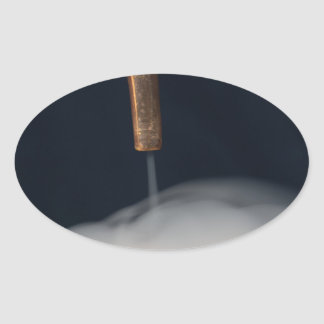 copper pipe of a distillery with steam. oval sticker