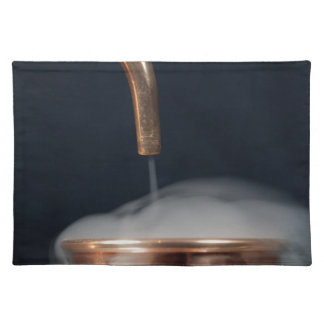 copper pipe of a distillery with steam. placemat