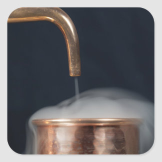 copper pipe of a distillery with steam. square sticker