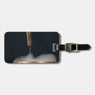 Copper pipe with steam luggage tag
