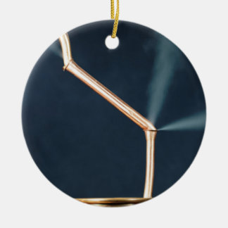 Copper pipes with a leak and steam. ceramic ornament