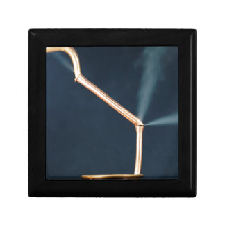 Copper pipes with a leak and steam. gift box