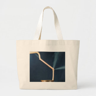Copper pipes with a leak and steam. large tote bag