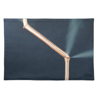 Copper pipes with a leak and steam. placemat