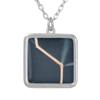 Copper pipes with a leak and steam. silver plated necklace