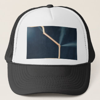 Copper pipes with a leak and steam. trucker hat