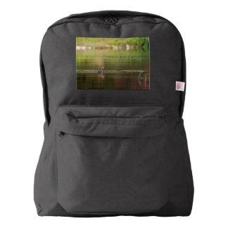 Cormorant bird swimming peacefully backpack