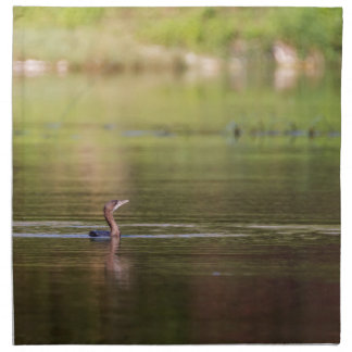 Cormorant bird swimming peacefully napkins