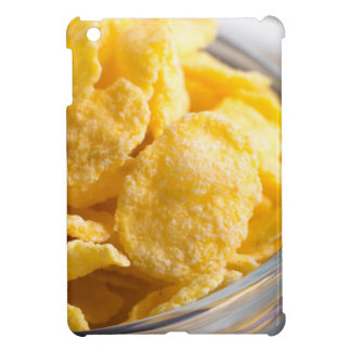 Cornflakes in a transparent bowl closeup cover for the iPad mini