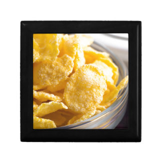 Cornflakes in a transparent bowl closeup gift box