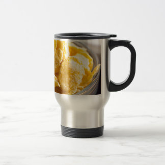Cornflakes in a transparent bowl closeup travel mug