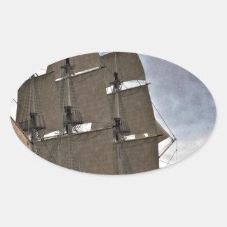 Corvette Sailing Vessel in Calm Waters Oval Sticker