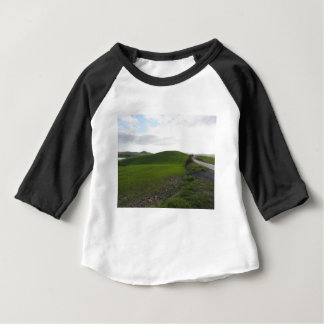 Country road over rolling green hills and valleys baby T-Shirt