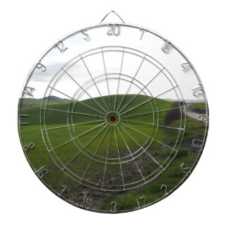 Country road over rolling green hills and valleys dartboard