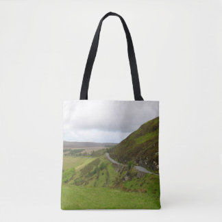 Countryside road bends around hill in Ireland Tote Bag
