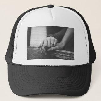 Couple hands trucker hat