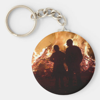 Couple in front of campfire basic round button key ring