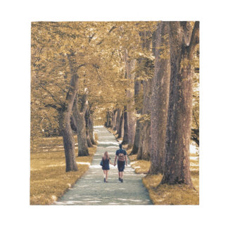 couple in the woods. notepad