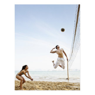 Couple Playing Beach Volleyball at Six Senses Postcard