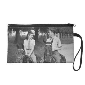 Couple Riding Horses Wristlet