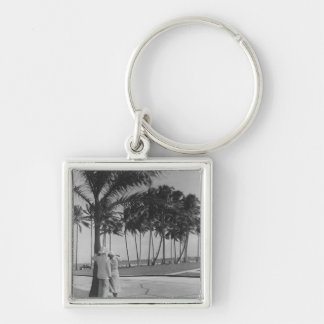 Couple standing at palm tree Rear view B&W Silver-Colored Square Key Ring