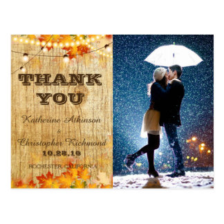 Couple with umbrella kissing at snow/fall theme postcard