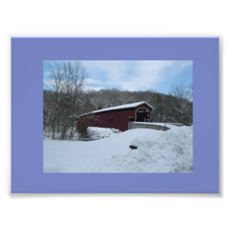 Covered bridge with a blanket of snow photo