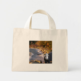 Cow at the Cabins Tote Bags