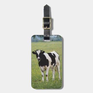 Cow in field of Wildflowers Luggage Tag