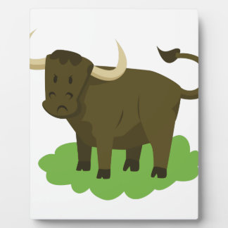 cow in the grass display plaques