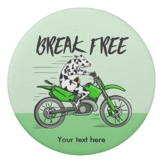 Cow riding a bright green motorbike eraser