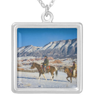 Cowboy and Cowgirl riding Horse through the Snow Square Pendant Necklace
