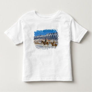 Cowboy and Cowgirl riding Horse through the Snow Tshirt