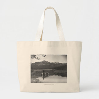Cowboy and horse in a pond large tote bag