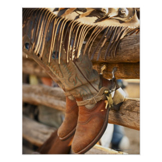 Cowboy boots on fence 2 poster