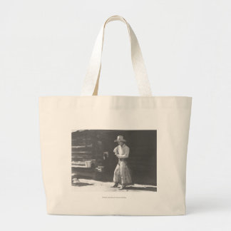 Cowboy eating from a Peter Pan peanutbutter can. Large Tote Bag