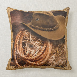 Cowboy hat and lariat on straw bale throw pillow