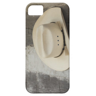 Cowboy hat hanging on wall of log cabin iPhone 5 cover