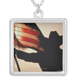 Cowboy holding Stars and Stripes, silhouette, Necklaces