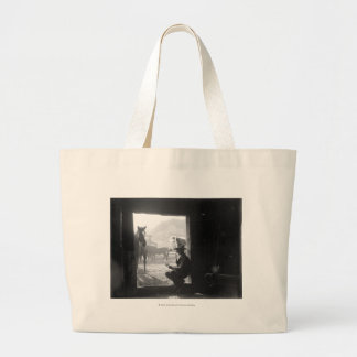 Cowboy in a doorway with horses large tote bag