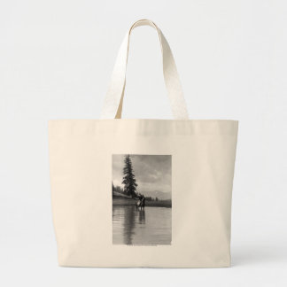 Cowboy in a pond large tote bag