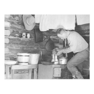Cowboy making coffee inside the bunkhouse postcard