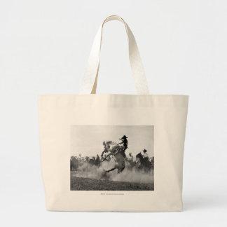 Cowboy on a bucking bronco canvas bag