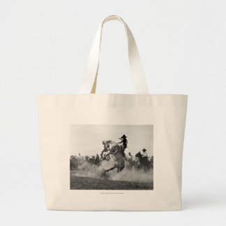 Cowboy on a bucking bronco large tote bag