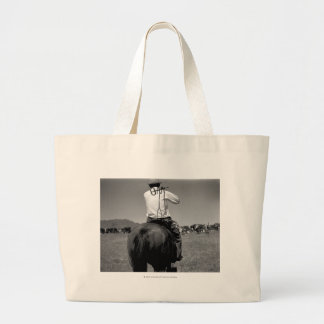 Cowboy on a horse with two brands. large tote bag