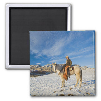 Cowboy on his Horse in the Snow 2 Square Magnet