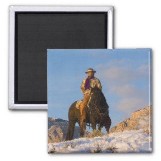 Cowboy on his Horse in the Snow Square Magnet